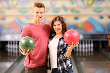 Beautiful couple at bowling club