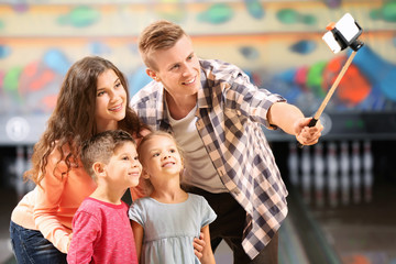 Family taking selfie at bowling club