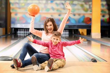 Family having fun in bowling club