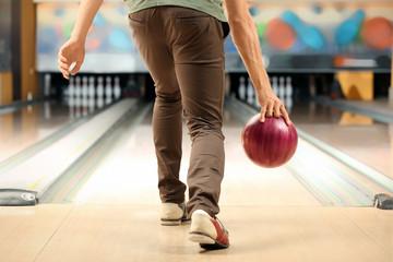Young man at bowling club
