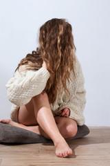 Woman straightens hair
