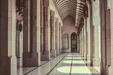 Sun pours into beautiful empty stone corridor