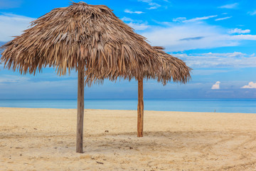 Beach in the Caribbean and umbrellas.