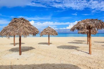 Beach in the Caribbean and umbrellas.