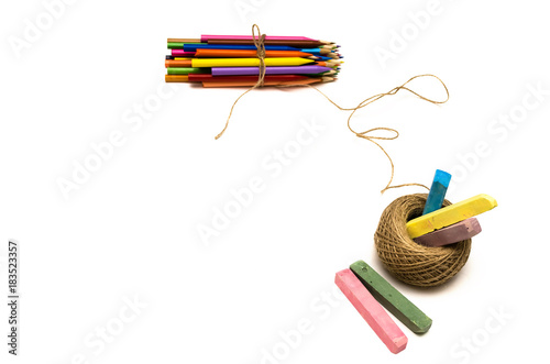 Pile of colored pencils tied with a jute rope and colorful