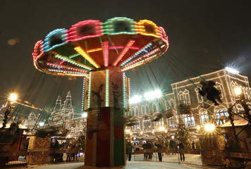 People ride a merry-go-round in Red Square in Moscow