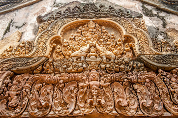 Architectural detail at Banteay Srei, a 10th century Hindu temple dedicated to Shiva. The temple built in red sandstone was rediscovered 1814 in the jungle of the Angkor area of Cambodia.