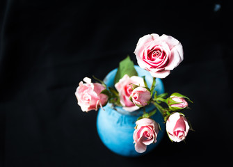 See to it, there is something sweet about this pink rose in blue vase