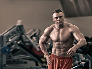 Naked athletic bodybuilder