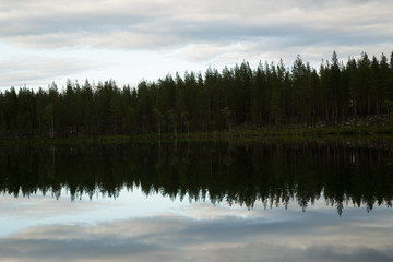 Tuinposter Wit Lake in Northern Sweden, reflection