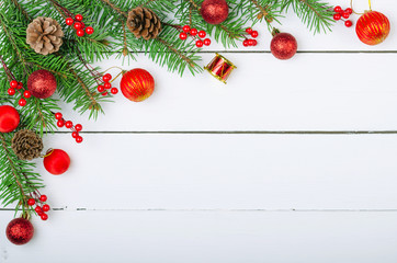 Christmas wooden background with Christmas tree branches and Xmas decorations.