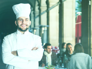 Portrait of male chef standing in restaurant
