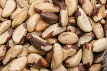 Tasty brazilian nut background. Horizontal image. Background of nuts texture.