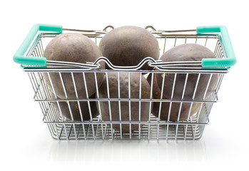 Passion fruits in a shopping basket isolated on white background.