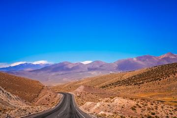 Empty paved road through Nevado Sajama National Park