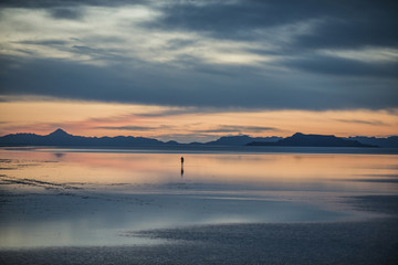 Tranquil view of Bonneville Salt Flats against stormy clouds during sunset