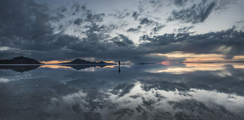 Panoramic view of Bonneville Salt Flats against cloudy sky during dusk