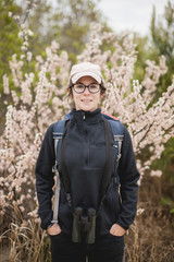 Portrait of confident female hiker with hands in pockets standing at Redwood National and State Parks