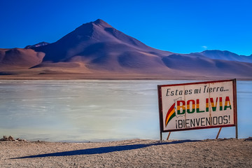 Board marking proximity of border between Bolivia and Chile