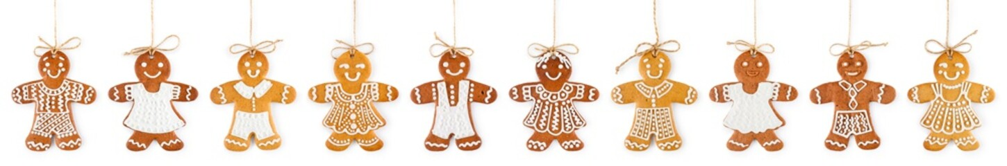 Christmas border and ornament from gingerbreads boys and girls on ropes - sweet cookies, isolated on white background