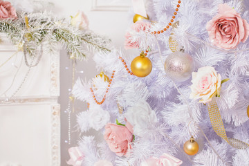 Festive New Year background. Christmas card. Toy hanging on a white pine tree