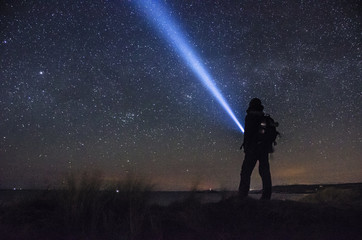 Exploring the night sky with a torch in hand