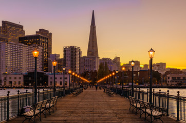 Downtown San Francisco and the Transamerica Pyramid at Christmas from wooden Pier 7 at sunset