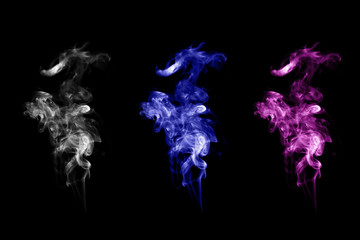 White smoke and colorful smoke on dark black background