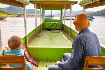 Tourists enjoy boat trip by Mekong river. Laos.