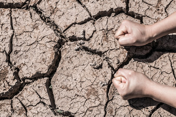 Hands on the ground crack because of drought.