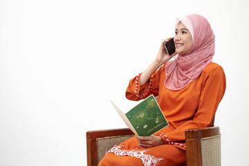 malay girl with tudung on the line