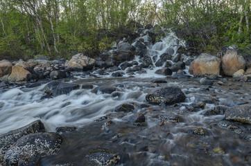 Waterfall,black stones ,summer.
