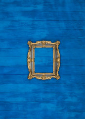 gallery of vintage victorian golden frames isolated on blue wooden wall