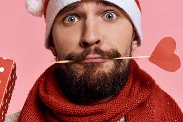 man with a beard, artificial heart in his mouth, portrait, new year