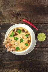 Tom Yam, traditional Thai soup with shrimps and mushrooms
