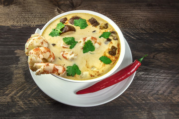 Tom Yam, traditional Thai soup with shrimps and mushrooms, with chilli pepper