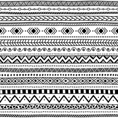 Seamless ethnic pattern. Black and white striped background. Aztec and tribal motifs. Prints for textiles.