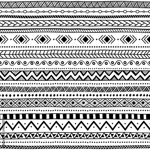 Seamless ethnic pattern black and white striped background aztec and tribal motifs prints
