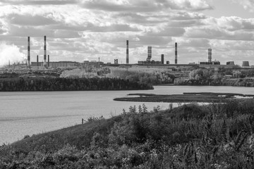 river on the background of industrial landscape, black-and-white photo of the Iset river in the Urals