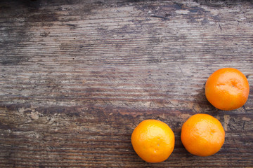 Christmas still life with mandarins on a wooden board