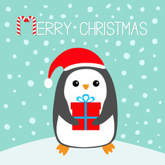 Merry Christmas Candy cane. Penguin on snowdrift. Santa Claus red hat. Gift box. Cute cartoon kawaii funny animal character. Flat design. Winter blue snow background. Greeting card.
