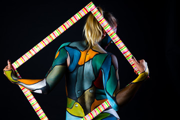 Back of model like stained glass body painting in  frame