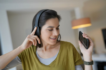 Woman listening to music with bluetooth headset
