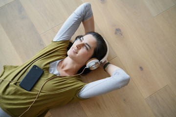 Woman listening to music with smartphone and headphones