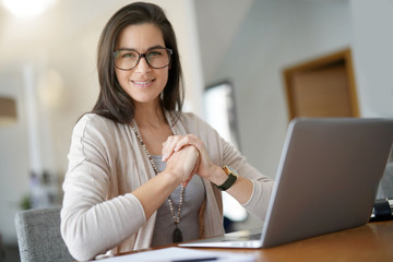 Portrait of smiling middle-aged active woman working from home