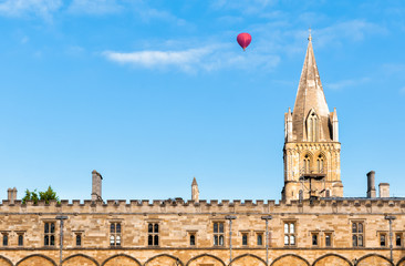 View of Christ Church with hot ballon flying passed over, Oxford University, United Kingdom