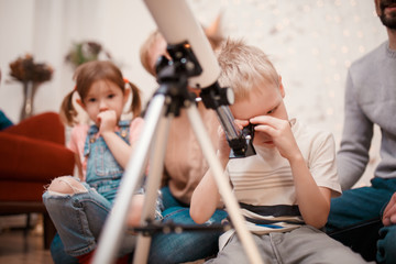 Picture of happy family with telescope