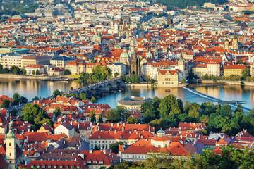 .Panoramic view of the evening Prague, the Vltava River and Charles Bridge. Czech Republic.