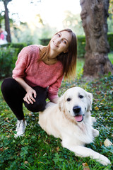 Picture of woman hugging dog on lawn