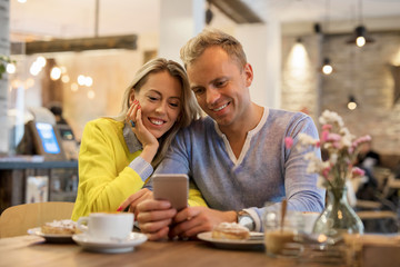Couple looking at smartphone together